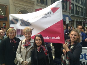 Karen Cairney, Principal Nolan, me and Caitlin Clements - holding our Napier banner with pride!