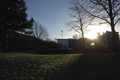 Sun rising over university buildings