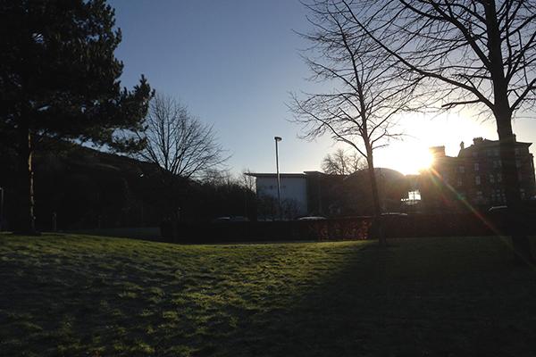 Sun rising over university buildings