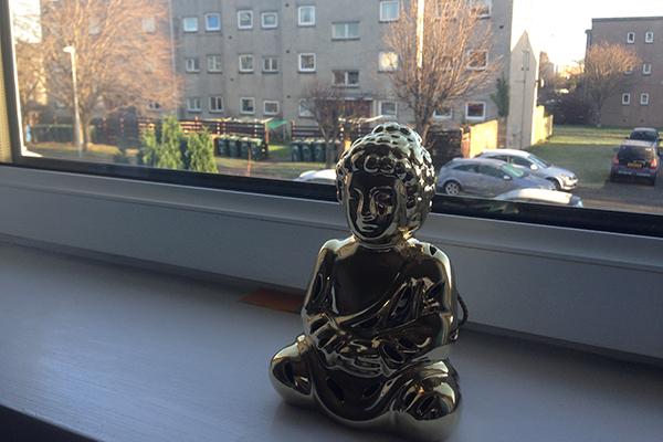 Image of Buddha on a windowsill