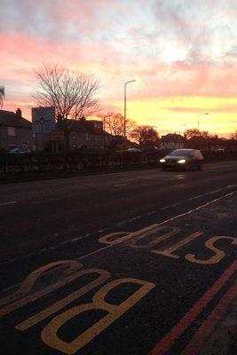 Sunset image car on road