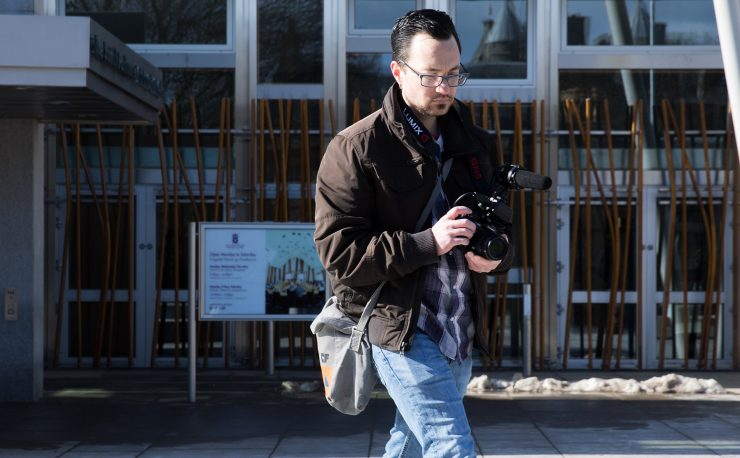 Film student Chris outside the Scottish Parliament.