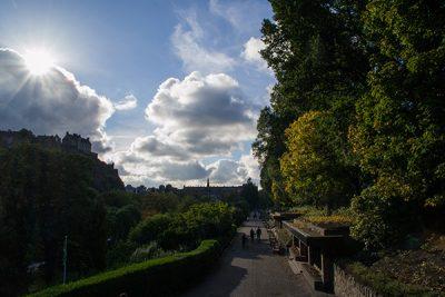Sunny view of Princes Street Gardens and Edinburgh Castle.
