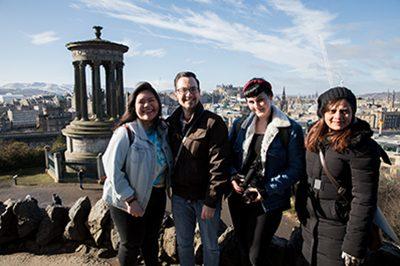 Four international student ambassadors at the top of Calton Hill.