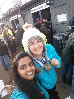 Two international student ambassador' at the rugby.